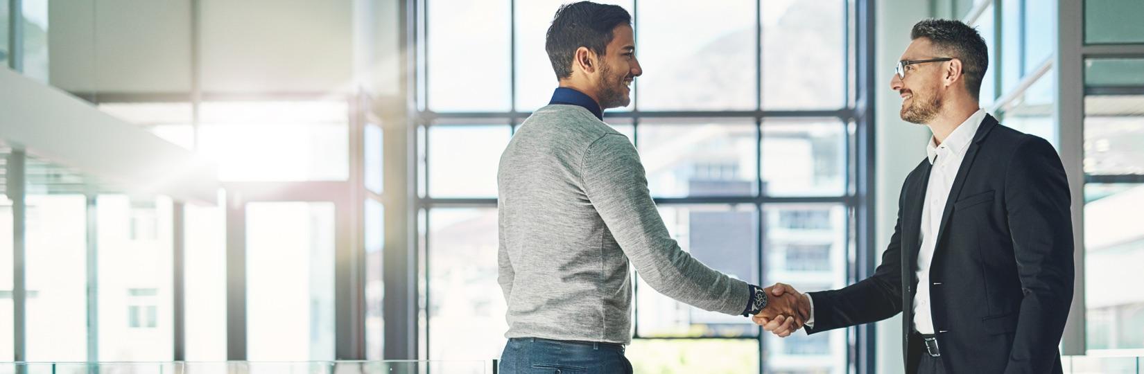 image of men shaking hands